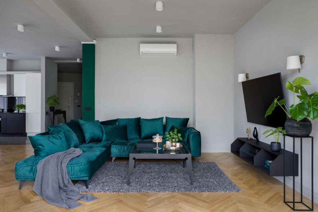 How To Decorate Around A Dark Green Sofa 9 What color TV stands go well with a dark green sofa
