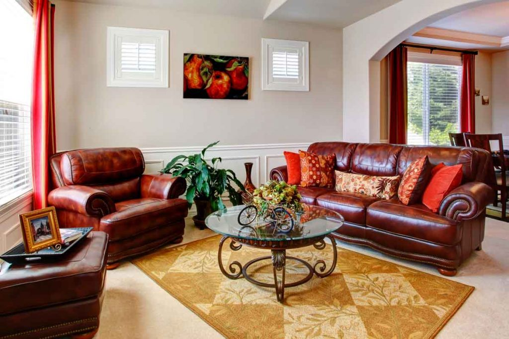 What color coffee tables go well with a brown leather sofa