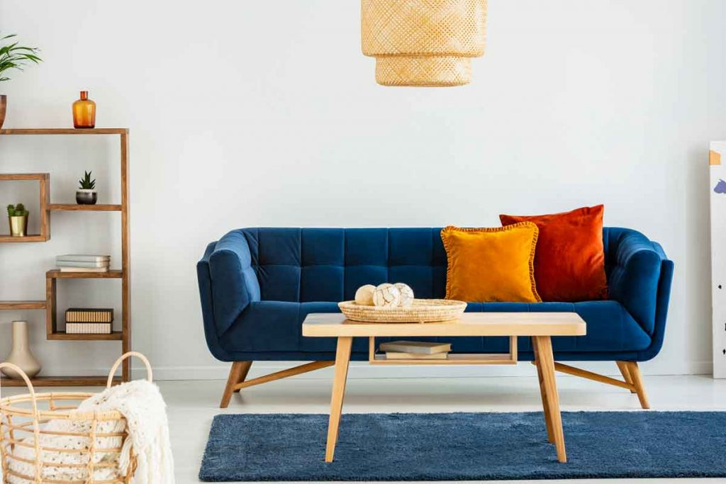 What color coffee tables go well with a navy blue sofa
