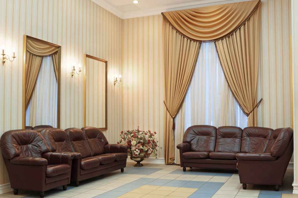 What color curtains go well with a brown leather sofa