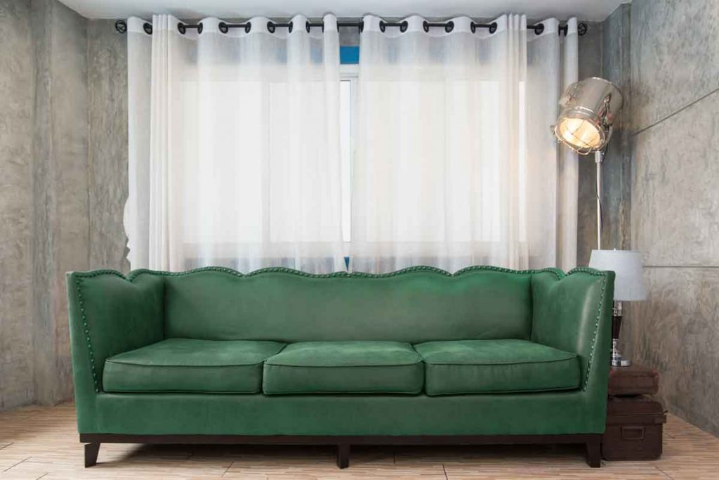 How To Decorate Around A Dark Green Sofa 6 What color curtains go well with a dark green sofa