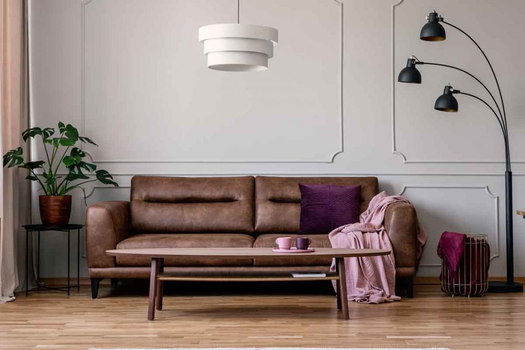 color scheme goes best with a brown leather sofa